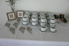 Coffee or tea cups and saucers and teaspoons
