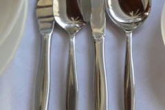 Soup spoon, main knife, dessert spoon and entree knife