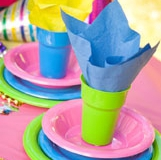 Coloured cups plates and napkins