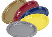 Assorted coloured oval dinner plates